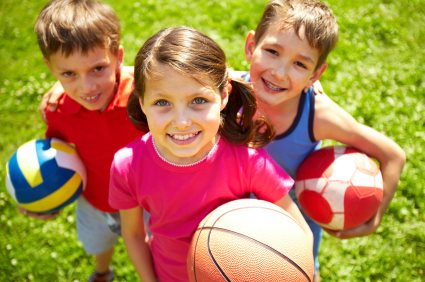Children-holding-footballs-Cropped-425x282